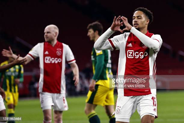 Ajax' Dutch defender Devyne Rensch celebrates following the 1-0 during the Dutch Eredivisie match between Ajax Amsterdam and ADO Den Haag at the...