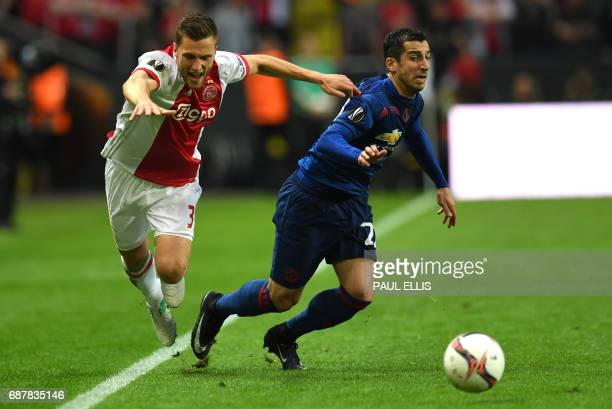 Ajax Dutch defender Joel Veltman vies for the ball with Manchester United's Armenian midfielder Henrikh Mkhitaryan during the UEFA Europa League...