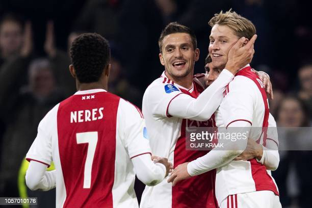 Ajax' Dutch midfielder Frenkie de Jong celebrates with teamates after scoring their second goal during the Dutch Eredivisie football match between...