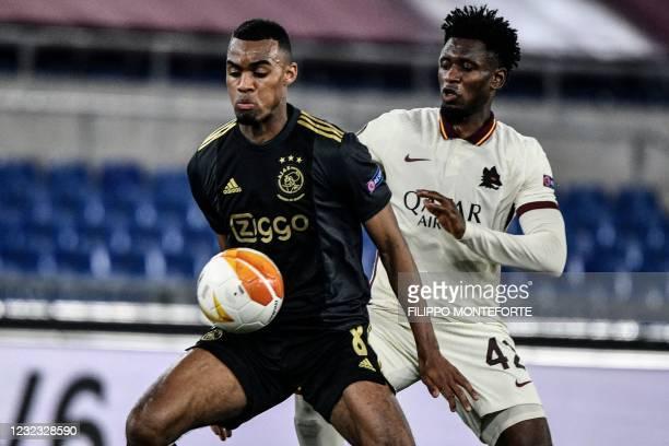 Ajax Dutch midfielder Ryan Gravenberch works around Roma's Guinean midfielder Amadou Diawara during the UEFA Europa League quarter final second leg...