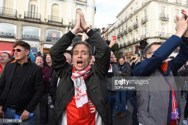 Ajax fans are seen shouting slogans before the football march in Madrid Nearly 4500 AJAX fans travelled to Madrid to watch the UEFA Champions League...