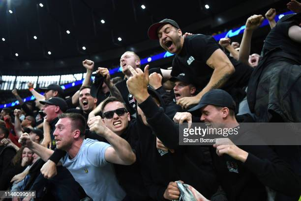 Ajax fans celebrate as Donny van de Beek scores his team's first goal during the UEFA Champions League Semi Final first leg match between Tottenham...