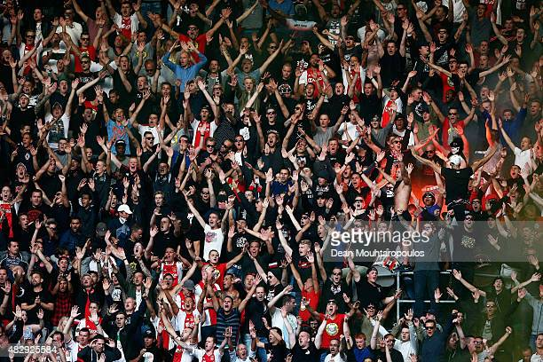 Ajax fans cheer and show their support during the third qualifying round 2nd leg UEFA Champions League match between Ajax Amsterdam and SK Rapid...