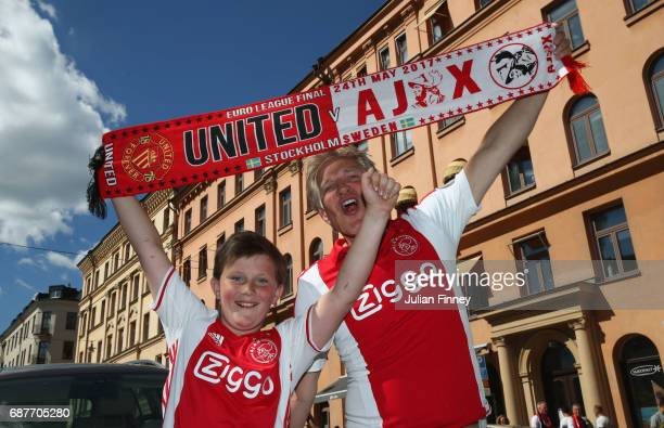 Ajax fans enjoy the city centre atmosphere prior to the UEFA Europa League Final between Ajax and Manchester United on May 24 2017 in Stockholm Sweden