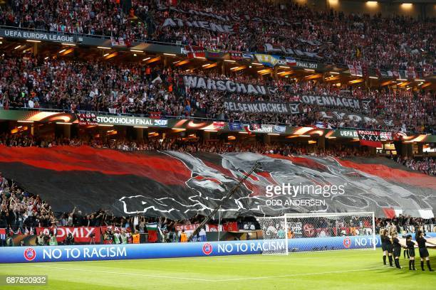 Ajax fans hold a giant banner prior to the UEFA Europa League final football match Ajax Amsterdam v Manchester United on May 24 2017 at the Friends...