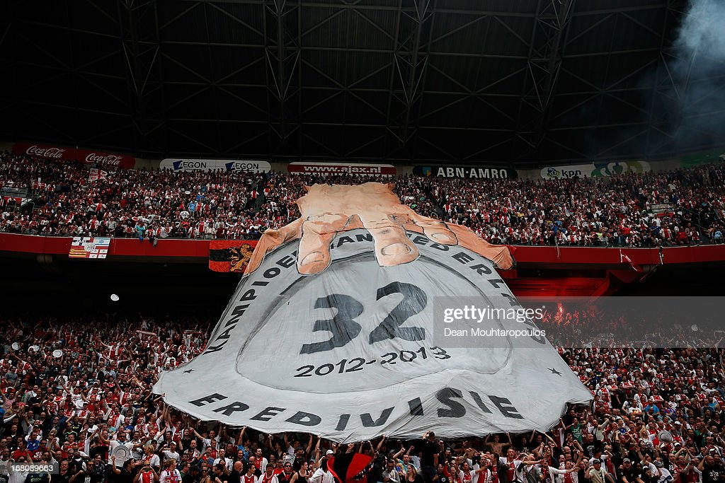 Ajax fans hold a massive banner showing a hand on their 32nd Champions of Holland Trophy during the Dutch Eredivisie match between Ajax and Willem II Tilburg at Amsterdam Arena on May 5, 2013 in Amsterdam, Netherlands.