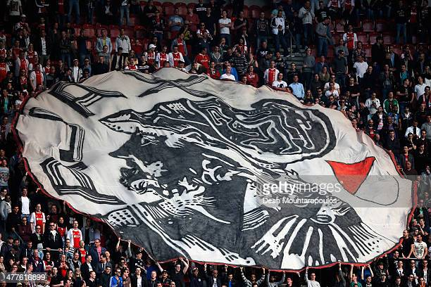 Ajax fans show their support with a giant flag during the Eredivisie match between Ajax Amsterdam and SC Cambuur Leeuwarden at Amsterdam Arena on...