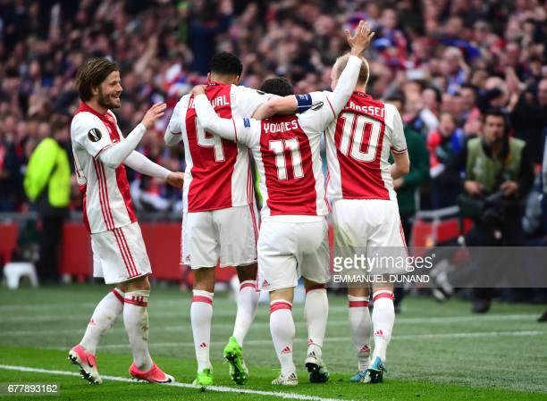 Ajax forward Amin Younes reacts after scoring during UEFA Europa League semifinal first leg Ajax Amsterdam v Olympique Lyonnais on May 3 2017 in...