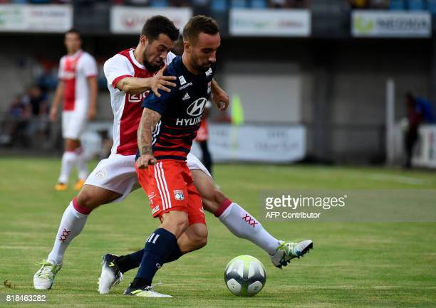 Ajax forward Amin Younes vies with Lyon's Spanish midfielder Sergi Darder during a friendly football match between Olympique Lyonnais and Ajax...