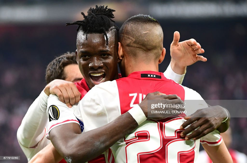 Ajax forward Bertrand Traoré (L) reacts after fourth goal during UEFA Europa League semi-final, first leg, Ajax Amsterdam v Olympique Lyonnais on May 3, 2017 in Amsterdam. / AFP PHOTO / Emmanuel DUNAND