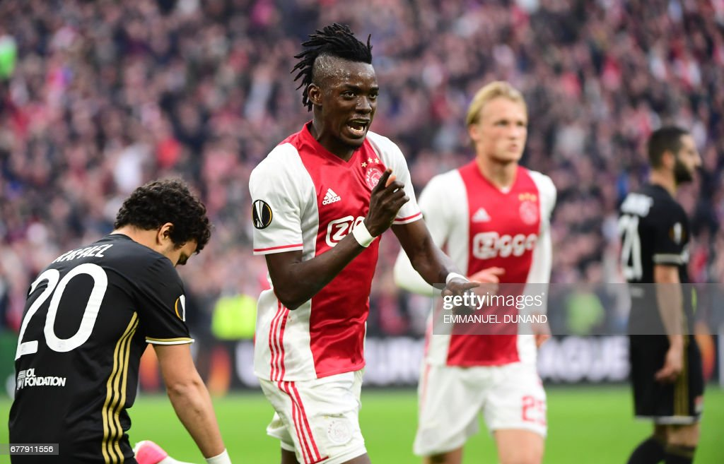 Ajax forward Bertrand Traoré (C) reacts after fourth goal during UEFA Europa League semi-final, first leg, Ajax Amsterdam v Olympique Lyonnais on May 3, 2017 in Amsterdam. / AFP PHOTO / Emmanuel DUNAND