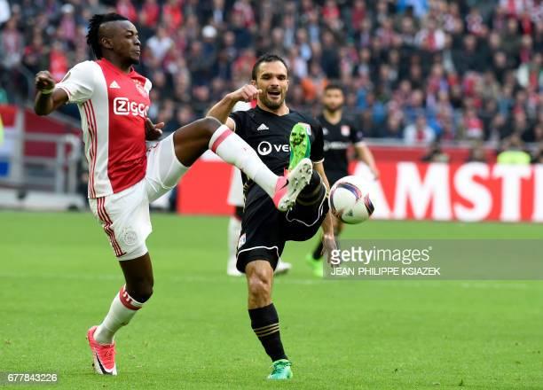 Ajax forward Bertrand Traoré vies with Lyon's French defender Jeremy Morel during UEFA Europa League semifinal first leg Ajax Amsterdam v Olympique...