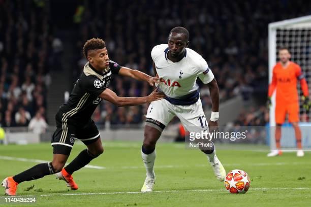 Ajax forward David Neres pushes off Tottenham midfielder Moussa Sissoko during the UEFA Champions League match between Tottenham Hotspur and Ajax...