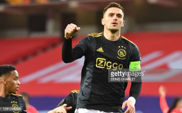 Ajax' forward Dusan Tadic celebrates scoring his team's first goal during the UEFA Europa League round of 32 first leg football match between Lille...
