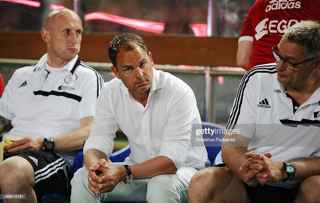 Ajax head coach, Frank De Boer (C) sit on the bench during the international friendly match between Perija Jakarta and AFC Ajax on May 11, 2014 in Jakarta, Indonesia. AFC Ajax win the game 3-0.