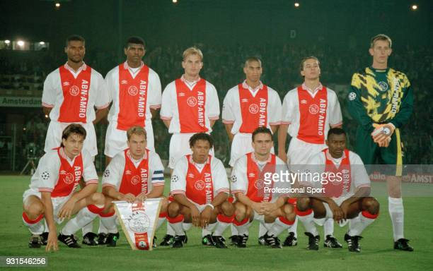 Ajax line up for a group photo before the UEFA Champions League match between Ajax and Real Madrid at the Olympic Stadium on September 13 1995 in...