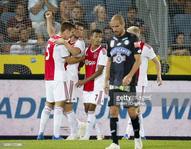 Ajax' Maximilian Woeber, Klaas-Jan Huntelaar and David Neres react as Graz' Fabian Koch looks on during the UEFA Champions League second qualifying...