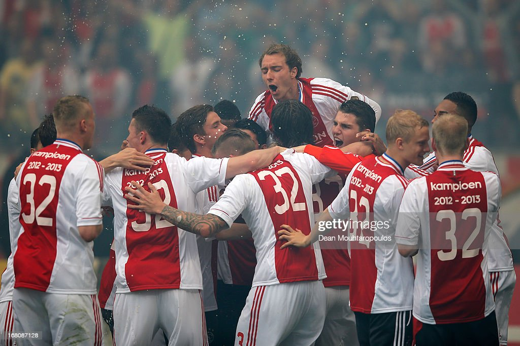 Ajax player, Christian Eriksen jumps on his teammates as they win the Eredivisie Championship trophy after the match between Ajax and Willem II Tilburg at Amsterdam Arena on May 5, 2013 in Amsterdam, Netherlands.