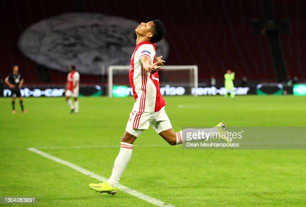 Ajax player David Neres celebrates after scoring the second Ajax goal during the UEFA Europa League Round of 32 match between AFC Ajax and Lille OSC...