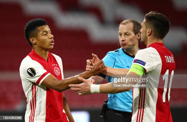 Ajax player David Neres celebrates with team mate Dusan Tadic after scoring the second Ajax goal whilst referee William Collum tries to intervene...