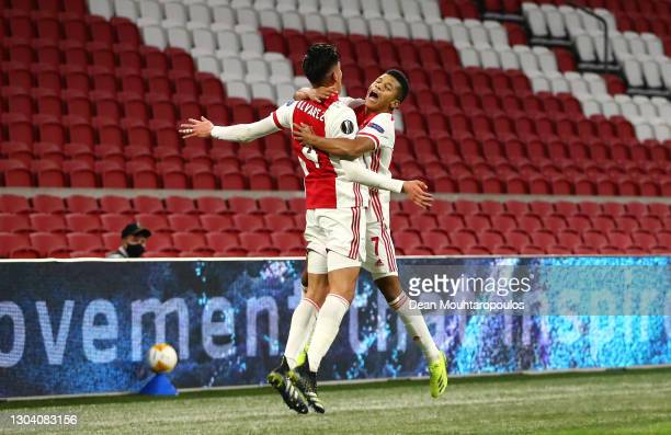 Ajax player David Neres celebrates with team mate Edson Alvarez after scoring the second Ajax goal during the UEFA Europa League Round of 32 match...