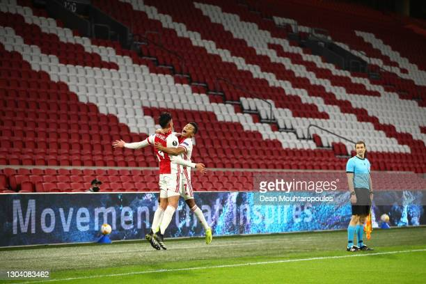 Ajax player David Neres celebrates with team mate Edson Alvarez after scoring the second Ajax goal as the assistant referee looks on during the UEFA...