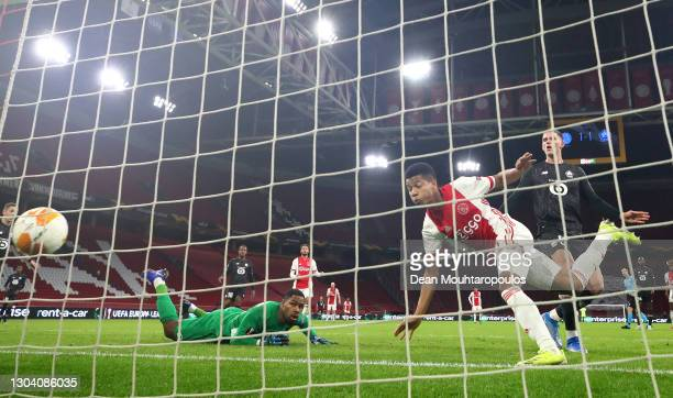 Ajax player David Neres scores the second Ajax goal past Lille goalkeeper Mike Maignan during the UEFA Europa League Round of 32 match between AFC...