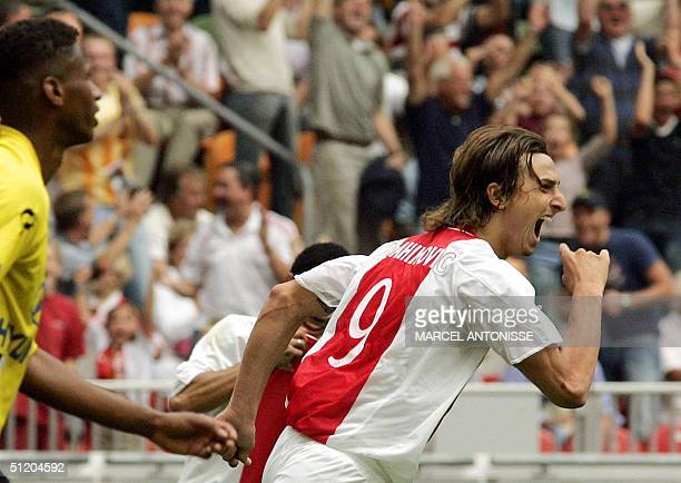 Ajax player Zlatan Ibrahimovic celebrates beside NAC player David Mendes da Silva after scoring in the Dutch premier league against NAC 22 August...
