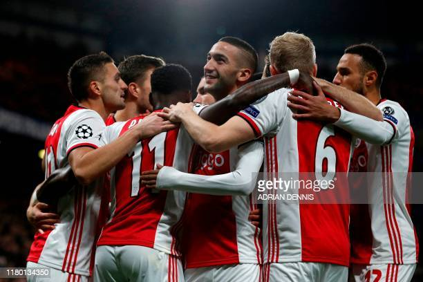 Ajax players celebrate after scoring the opening goal during the UEFA Champion's League Group H football match between Chelsea and Ajax at Stamford...