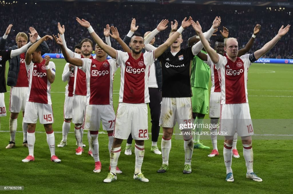 Ajax players celebrate after the 4-1 victory in UEFA Europa League semi-final, first leg, Ajax Amsterdam v Olympique Lyonnais (OL) on May 3, 2017 in Amsterdam. /