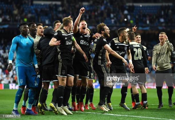 Ajax players celebrate victory after the UEFA Champions League Round of 16 Second Leg match between Real Madrid and Ajax at Bernabeu on March 05 2019...