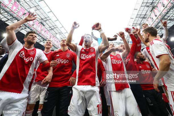 Ajax players celebrate winning the Eredivisie title at the end of the Eredivisie match between Ajax and Utrecht at Johan Cruyff Arena on May 12 2019...