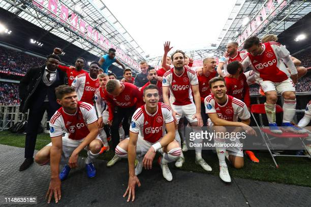 Ajax players celebrate winning the Eredivisie title at the end of the Eredivisie match between Ajax and Utrecht at Johan Cruyff Arena on May 12, 2019...