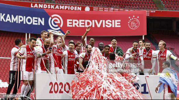 Ajax' players celebrate winning their 35th national title after the Dutch Eredivisie football match between Ajax Amsterdam and FC Emmen at the Johan...