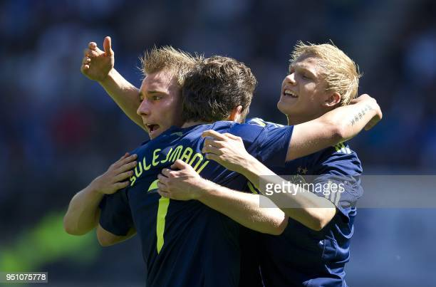 Ajax players Miralem Sulejmani Christian Eriksen and Nicolai Boilesen celebrate after scoring during the Dutch Eredivisie football match against...