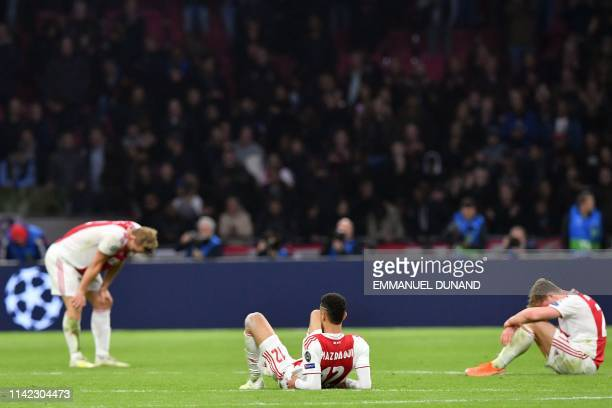 Ajax players react after losing the UEFA Champions League semifinal second leg football match against Tottenham at the Johan Cruyff Arena in...