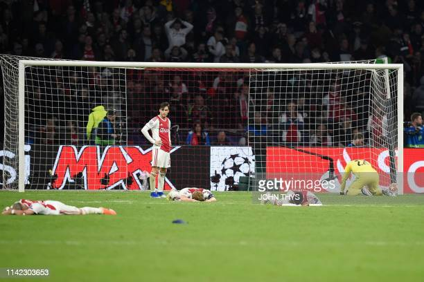Ajax players react after losing their UEFA Champions League semifinal second leg football match against Tottenham at the Johan Cruyff Arena in...