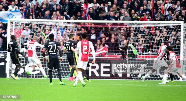 Ajax players react after the opening goal by Ajax defender Davinson Sánchez during UEFA Europa League semifinal first leg Ajax Amsterdam v Olympique...