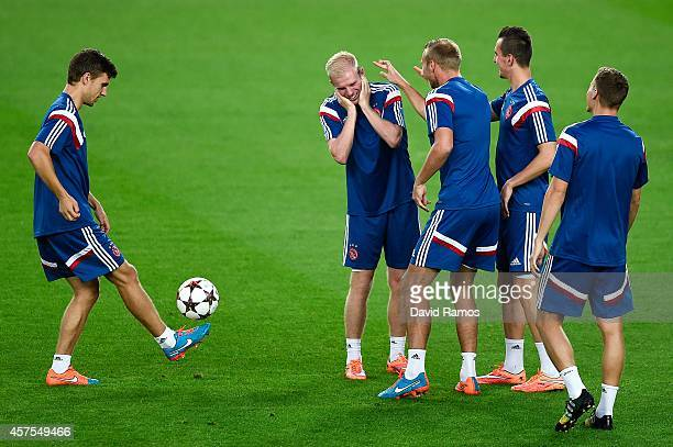Ajax players share a joke during a training session ahead of their UEFA Champions League Group F match against FC Barcelona at Camp Nou Stadium on...