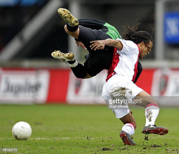 Ajax 's Edgar Davids in duel with Youssef El-Akchaoui of NEC as part of the Netherlands First Division soccer match held in Nijmegen, 20 January...