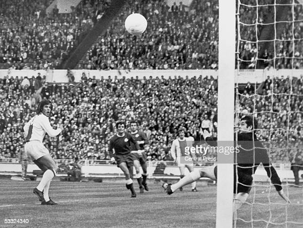 Ajax striker Dick Van Dijk watches his header pass the outstretched hand of Panathinaikos goalkeeper Takis Economopoulos to put his team 10 ahead in...