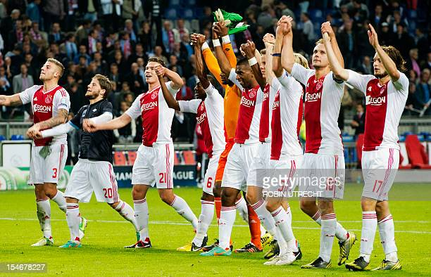 Ajax' team members celebrate their team's 31 win during the UEFA Champions League group D football match Ajax Amsterdam vs Manchester City on October...