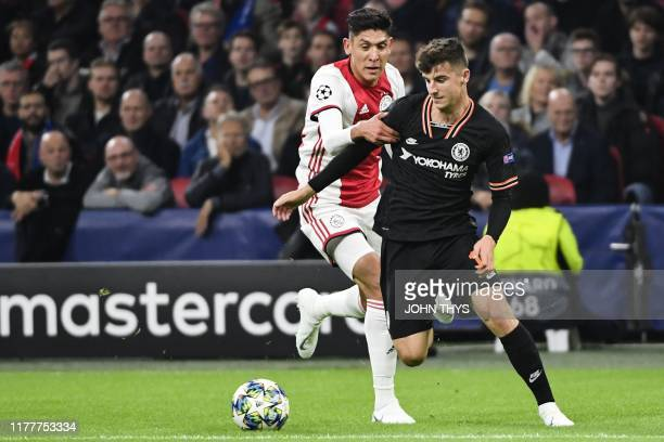 Ajax'Mexican midfielder Edson Alvarez fights for the ball with Chelsea's English midfielder Mason Mount during the UEFA Champions League Group H...