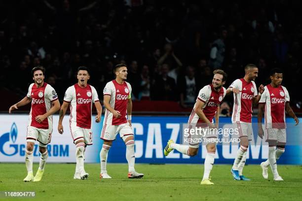 Ajax's Argentine defender Nicolas Tagliafico celebrates with teammates after scoring a goal during the UEFA Champions league Group H football match...