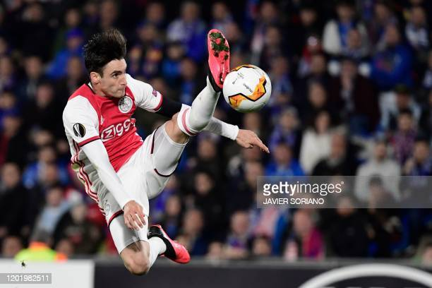 Ajax's Argentine defender Nicolas Tagliafico kicks the ball during the Europa League round of 32 football match between Getafe CF and Ajax Amsterdam...
