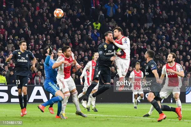 Ajax's Argentine defender Nicolas Tagliafico scores a goal which will be rejected after VAR deliberation during the UEFA Champions league round of 16...