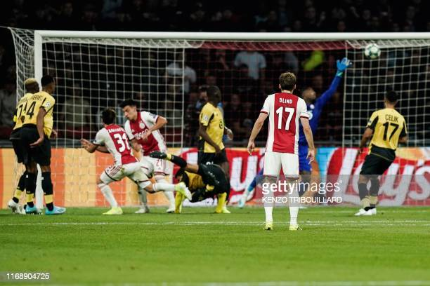 Ajax's Argentine defender Nicolas Tagliafico shoots and scores a goal during the UEFA Champions league Group H football match between Ajax FC...