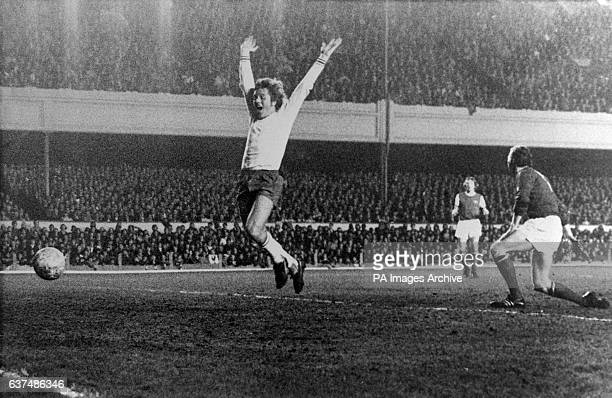 Ajax's Arie Haan raises his arms in celebration as George Graham heads the ball into his own net