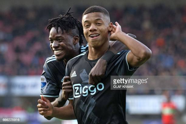 Ajax's Bertrand Traore celebrates with Ajax's David Neres after scoring a goal during the eredivisie match between NEC Nijmegen and Ajax on April 8,...