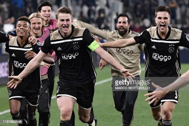 Ajax's Brazilian forward David Neres Ajax's Dutch defender Matthijs de Ligt Ajax's Dutch defender Joel Veltman and teammates celebrate after...